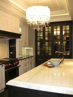 Gorgeouse glam black and white kitchen..but those mirrored cupboard doors are just FABULOUS!!!