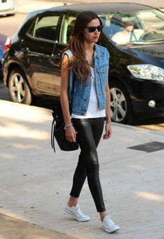 Denim vest, pleather leggings, and white chucks paired with red lipstick.
