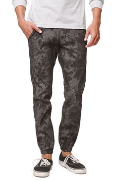 A PacSun Online Exclusive! Kennedy pairs fashion and function with these men's jogger pants found at PacSun. The Chambray Jogger Pants come with a cool black base and a subtle floral print throughout.%09Two tone print jogger pants%09Kennedy patch sewn on back%09Traditional five pocket design%09Button waist, zip fly%09Machine washable%0998% cotton, 2% spandex%09Imported