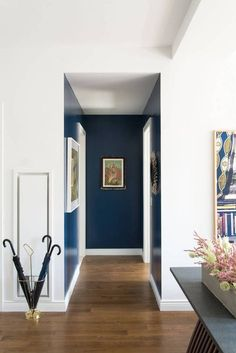 Domino shares an NYC home made-over by design service Homepolish, using several beautiful prints and bold colors. See inside a Homepolish makeover in NYC. Blue Hallway, Entry Hallway, Diy Interior, Interior Design, Hallway Decorating, Entryway Decor, Entryway Ideas, Fall Decorating, Wall Decor