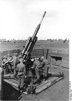German 88 mm flak gun in action against Allied bombers. One of the most potent AA guns ever designed, the 88 saw heavy action throughout WW2. Such was the devastating effects of the 88 that it was also used in anti-tank and anti-ground defense buster roles. Toward the end of the war, the Germans experimented with deploying 88s on armored platforms and a number of 88-armed tank designs were tested.