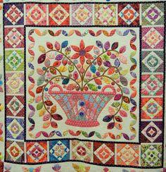 Flower Basket Medallion by Renee Caswell, design by Kim McLean.  Fabrics by Kaffe Fassett.
