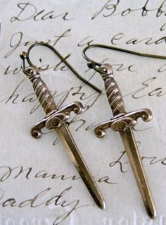 Dagger Knife Earrings - Vintage Brass. $19.00, via Etsy.