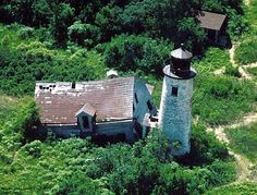 Charity Island Lighthouse before restoration, this lighthouse is located on an island in the middle of Saginaw Bay of Lake Huron off the coast of Caseville, Michigan
