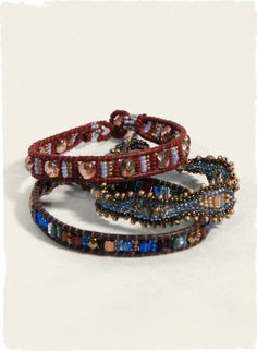 The leather and glass beaded bracelets add a bohemian accent.