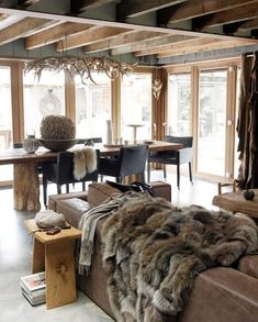 A Dutch winter house. Love the Dining Table and the throw on the couch.