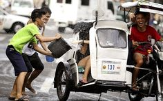 I doubt these people know each other. Water celebration for the Feast of John the Baptist in the Philippines.