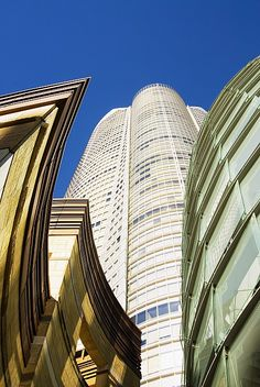 ✮ Japan, Tokyo, Roppongi Hills, upward view of Mori Tower framed by glass and stone of lower structures