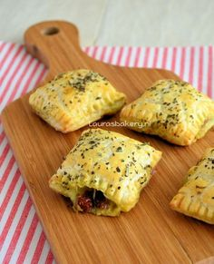 savory puff pastry bites with pesto, mozzarella, serano ham and sundried tomatos.