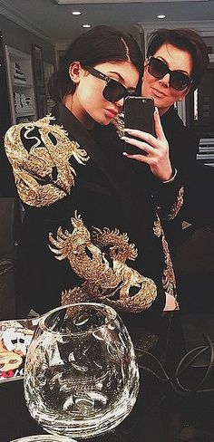 Kylie Jenner wearing Justin Bieber's gold Balmain dragon-covered jacket.