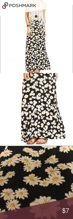 American Rag Daisy Skirt Super stretchy and comfortable! Wide waist with single line in the back. Material is somewhat faded though there are no tips or stains. Waist is 12 inches ( not stretched ) and length is 37 inches. American Rag Skirts Maxi