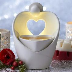 "Love getting ready for the holidays!  Angel Heart ScentGlow Warmer - Modern angel sculpted from glazed ceramic speaks to the heart. Electric warmer radiates a soft glow while releasing the fragrance of Scent Plus® Melts, sold separately. White cord. 7"", 5¼""w. #PartyLite"