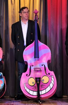 Cheshire Cat Bass..animator Douglas Rogers attends Disney's and The Grammy Foundation's unveiling of 5 unique hand painted upright basses designed by Walt Disney Animation artists at The GRAMMY Museum on February 4, 2010 in Los Angeles, California.