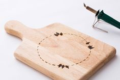 Start your burners and personalize a wood serving board.