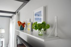Long picture/home dec shelf on long wall in living room/dinning room  From Young House Love.