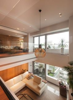 Natural modern decor living room. I love the over looking balcony area upstairs.
