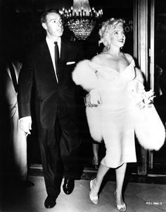 Marilyn Monroe and Joe DiMaggio at the premiere of 'The Seven Year Itch', 1955.