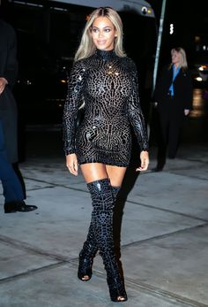 """Here is Beyonce wearing a little mini-dress plus some thigh high boots and looking like a hooker as she arrive at the """"Beyonce"""" album party in New York. Description from gutteruncensored.me. I searched for this on bing.com/images"""