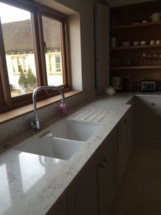This customer has installed a Bluci Vecchio G10 double bowl kitchen sink in a unique way. Normally this sink would be fitted with the front on display. However, due to the deeper worktops the customer has managed to cover the front, almost creating an undermount look!