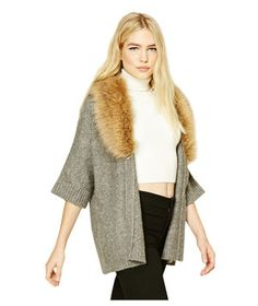 A touch of (faux) fur goes a long way toward making what could easily be a loungewear-only piece (a basic, gray cardigan) into a show-stopper that pulls together any outfit.