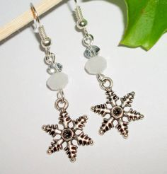 Winter snowflake cute antique silver dangle earrings..handmade by i.p.. $0.20, via Etsy.