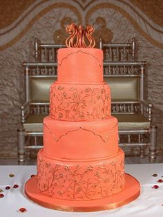 One tone apricot layer cake with 2 different piped designs based off wedding invitation