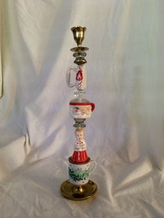 These are so cool!! Christmas trinket candlestick- Brass base and candle cup- Assorted salt and pepper shakers and ceramic finds