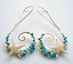 Made to order. Please refer to the shop announcement or the policies page for current production times. Genuine starfish are secured to golden tendrils, which are dotted with a mixture of blue and green stones including turquoise, apatite, peridot, and coral. The earring swirls