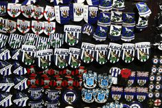 Badges are on sale near the stadium prior to kick off  during the Premier League match between West Bromwich Albion and Swansea City at The Hawthorns on December 14, 2016 in West Bromwich, England.