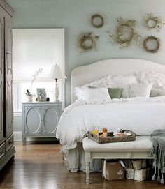 Ah my dream bedroom theme! Duck egg blue,dove gray,white,silver and hints of beige and earthy tones...to die!    how comfy does that bed look!