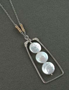 3 white coin pearls suspended in sterling frame, with gold wrap accents  #handmade #jewelry #pendant #necklace