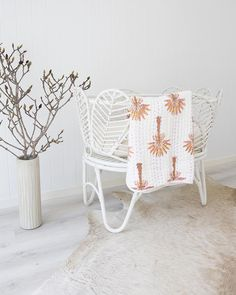 The Nala Bassinet is hand made showcasing whimsically rattan petal encased in a solid rattan frame.