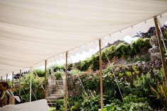A marquee set in the walled garden at Hatch House. Photo by Lydia Stamps Photography Walled Garden, Outdoor Furniture, Outdoor Decor, Stamps, Things To Come, Floral, Plants, Photography, House