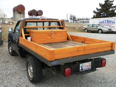 Custom Hand built all wooden truck bed made from recycled barn lumber, one of a kind wooden headache rack, and wooden chest tool box to match.