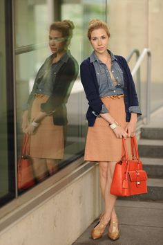 Fall look: orange herringbone a-line skirt with chambray button down over lace shell and navy cardigan. Orange bag, tan t-strap heels