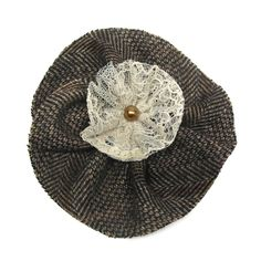 Saville Row is the name of this unique haute cuture flower brooch by Amalia Karageorgou. Made of houndstooth print cashmere and lace, it features sequin and pearl embellishment.Measurements: 11cm x 11cm.Pin fastening.