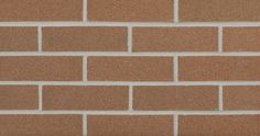 Burnt Orange (W23) is an orange extruded facebrick from our Hanley Plant #brick #orangebrick #brickhome #fireplace #backsplash