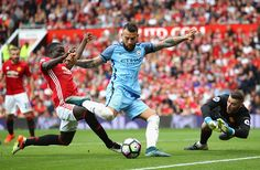 Nicolas Otamendi of Manchester City shoots while Eric Bailly of Manchester…