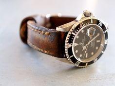 Vintage Rolex Submariner with well worn leather straps
