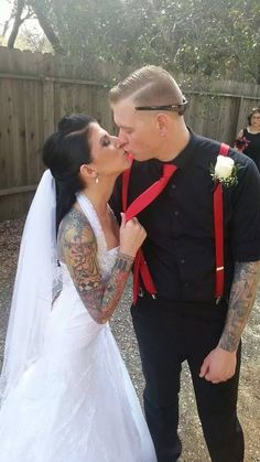 Kissing my new husband :) Red suspenders, red tie with black and red #converse