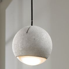 "Molded in a natural gray finished concrete, this pendant provides a unique urban contemporary design element. Metal Polished Chrome hardware contrasts beautifully with the black fabric covered wire. Powerful and efficient illumination is provided by included by the LED light source. 5 watt max GU10 LED lamp included. Dimmable. 3000k, 300 lumens. (7""Hx8""W) Supplied with 4.75"" canopy and 120"" of cable and wire."
