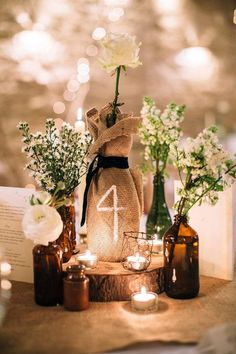 wine bottle and burlap table numbers and rustic wedding decor / http://www.deerpearlflowers.com/rustic-wedding-ideas-with-burlap-touches/2/