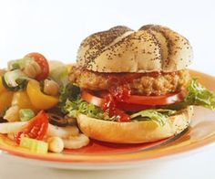 Use a portion of the chickpeas from a 15-ounce can for these chicken burgers; then use the remaining chickpeas to make a hearty chickpea side salad.