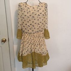 Topshop floral dress Topshop floral dress. Cream with blue flowers and yellow sleeve detail. Elastic band at waist makes it a flattering fit. Top is slightly sheer but skirt is lined. Polyester. Great condition. Topshop Dresses Long Sleeve