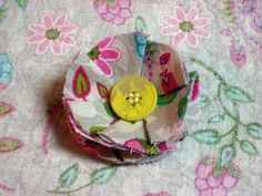 grey paisley print yoyo button flower clip