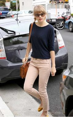 beige pants with a navy blue top.