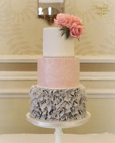 Grey ruffles and pink glitter wedding cake.