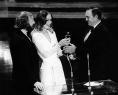 "Best Supporting Actor Ben Johnson (""The Last Picture Show"") with presenters Richard Harris and Sally Kellerman."