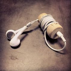 "He says ""Made this last night out of a cork to keep my headphones from getting tangled. #DIY"" Very smart. tangled phones are the worst."