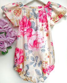 A beautiful short sleeve romper in a bold, bright print. Brighten up her wardrobe and show off her style with this baby play suit!  An eye catching pattern gives this floral romper a classic yet modern look, perfect for long summer days! This versatile style can also be layered over tights for cooler weather. Handcrafted boho romper - click for more details!